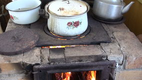 Old pots and fireplace in farm stock video