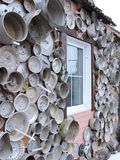 Old pots on home wall. Old pots collection  nail down to wall in Zagare town , Lithuania Royalty Free Stock Image