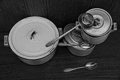 Old pots with lids with scoop and spoons