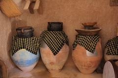 Pitchers in a Bedouin village with a pots and baskets stock photo