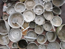 Old pots pattern. Old pots collection hanging on house wall, Lithuania Royalty Free Stock Image