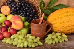 Old potters clay mug and colorful fruits, still life Royalty Free Stock Photo