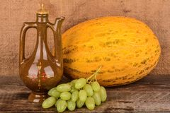Old potter's jug and fruit, still life Royalty Free Stock Photos