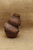 Old pottery on a background of burlap. Background for menu. Stock Photography