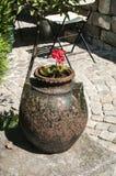 Old pottery in garden closeup Royalty Free Stock Photos
