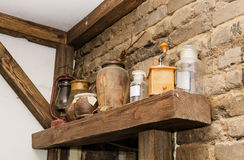 Old pottery and glass flasks with. A kerosene lamp stock image