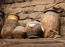 Old pottery and glass flasks with a. Kerosene lamp Royalty Free Stock Image