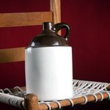 Old Pottery Jug on Chair Royalty Free Stock Photos