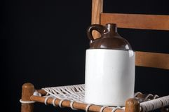 Old Pottery Jug on Chair Stock Photos