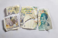 Old 5 pounds paper note torn apart Royalty Free Stock Photography