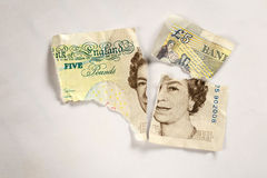 Old 5 pounds paper note torn apart Stock Photos