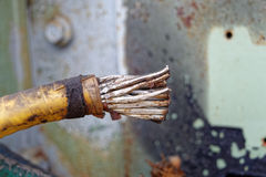 Old power cable. Old rusty broken power cable are cut Stock Photography