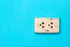 Old power outlet on green background Stock Photo