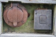 Old power outlet. And lighting switch Stock Images
