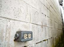 Outdoor power outlet on with brick wall stock photo
