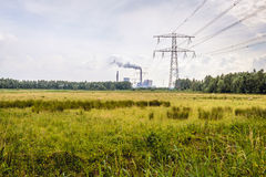 Old power plant fired by coal with high voltages lines Stock Photos