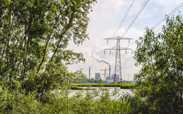Old power plant fired by coal with high voltages lines Stock Photography