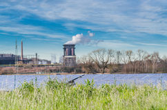Old power plant with solar panels Stock Photography