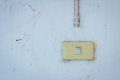Old power switch on a dirty wall. Royalty Free Stock Photo