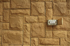 Old Power switch on the walls of the orange stone stacked beauti. Fully, White switch on the red brick wall Royalty Free Stock Photos