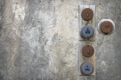 Old Power switches. On a grungy wall Stock Images