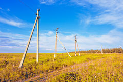 Old powerline at the field Royalty Free Stock Photo