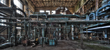 Deserted power plant interior Stock Images