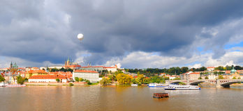Old Prague across Vltava river under Autumn sun Royalty Free Stock Image