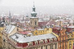 Free Old Prague Architecture And Red Roofs View From Above In Winter Snowfall Stock Images - 140370594