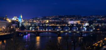 Old Prague; Bridges over Vltava river at dusk Stock Photos