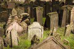 Old Prague Jewish Cemetery. A view of the old Jewish cemetery in Prague. The tombstones are uneven due to age stock images