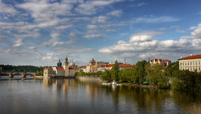 Old Prague Landmark Czech History Heritage. Old Town of Prague. Old Town Bridge Tower and Charles Bridge. The view across the surface of the river Vltava Royalty Free Stock Photography