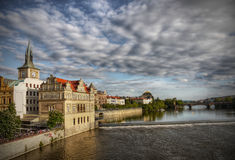 Old Prague Landmark Heritage UNESCO Cityscape. Amazing cloud formations in the sky and a view of the old town of Prague from Charles Bridge royalty free stock image