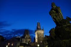 Old Prague towers in night stock image