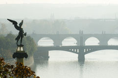 Old Prague. This is a morning view of the bridges on the Vltava River in Prague, Czech Republic. Mythologycal sculpture is in the foreground Stock Photography