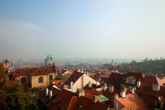 Old Prague roofs at autumn morning Royalty Free Stock Photo