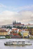 Old Prague, Vltava river under Autumn sun. View on Prague Castle across Vltava river; early autumn; sunlit old roofs under dramatic skies Stock Photography