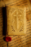 Old prayer book on antique letters Stock Photography