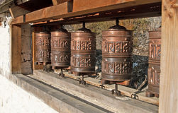 Old Prayer Wheels near village Ranipauwa, Nepal Royalty Free Stock Images