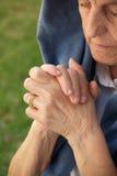 Old praying woman Stock Image