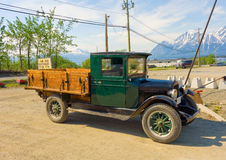 An old, preserved truck in northern canada with snow-capped rockies in the background Stock Photos