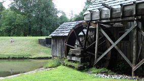 An old, preserved water wheel turning slowly at historic mabry mill stock video