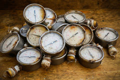 Old pressure gauge or damage pressure gauge of oil and gas industry on wooden background, Equipment of production process Stock Photo