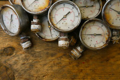 Old pressure gauge or damage pressure gauge of oil and gas industry on wooden background, Equipment of production process Royalty Free Stock Image