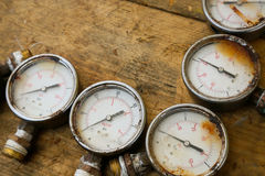 Old pressure gauge or damage pressure gauge of oil and gas industry on wooden background, Equipment of production process Stock Image