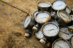 Old pressure gauge or damage pressure gauge of oil and gas industry on wooden background, Equipment of production process Stock Photography