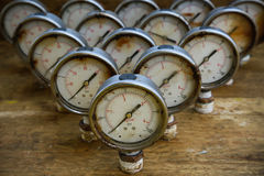 Old pressure gauge or damage pressure gauge of oil and gas industry on wooden background, Equipment of production process Royalty Free Stock Photos
