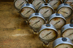 Old pressure gauge or damage pressure gauge of oil and gas industry on wooden background, Equipment of production process Royalty Free Stock Images