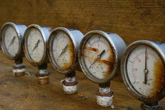 Old pressure gauge or damage pressure gauge of oil and gas industry on wooden background, Equipment of production process Stock Photos