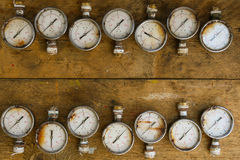 Old pressure gauge or damage pressure gauge of oil and gas industry on wooden background, Equipment of production process Stock Images